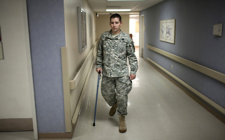 BATTLE FATIGUE: With severe PTSD, traumatic brain injury, a damaged hip and other war-related damage, Shawn Aiken was undergoing treatment and therapy as he limped from office to office at Fort Bliss, texas, seeking relief from the Pentagon's deductions from his pay. REUTERS/Ivan Pierre Aguirre