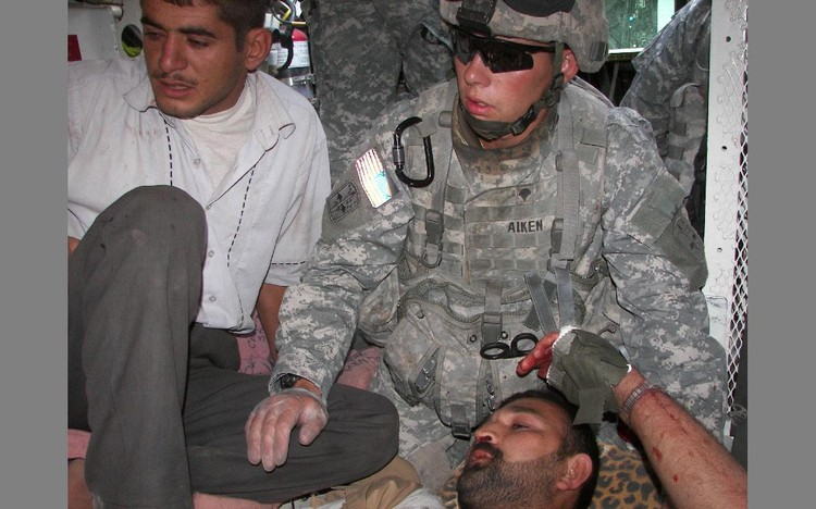 RECOGNITION DUE: Shawn Aiken was injured while serving in Iraq and Afghanistan, but the Pentagon s pay personnel failed to designate him as a wounded warrior on at least two occasions when doing so would have erased his alleged debts and prevented his family s ordeal. REUTERS/Handout Picture