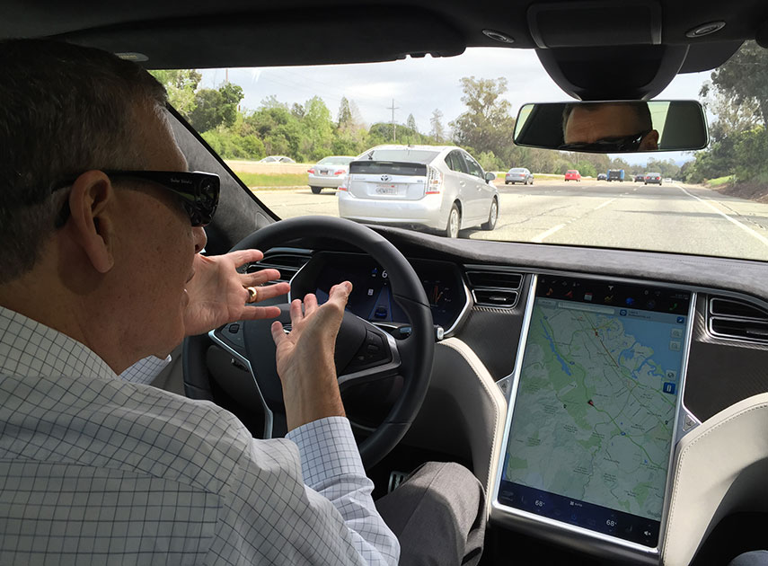 HANDS OFF Reuters Reporter Paul Ingrassia Rides In The Drivers Seat Of A Tesla Model S While Autopilot Mode Is One First Automakers To