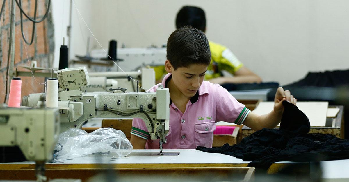 In Turkish sweatshops, Syrian refugee children sew to survive