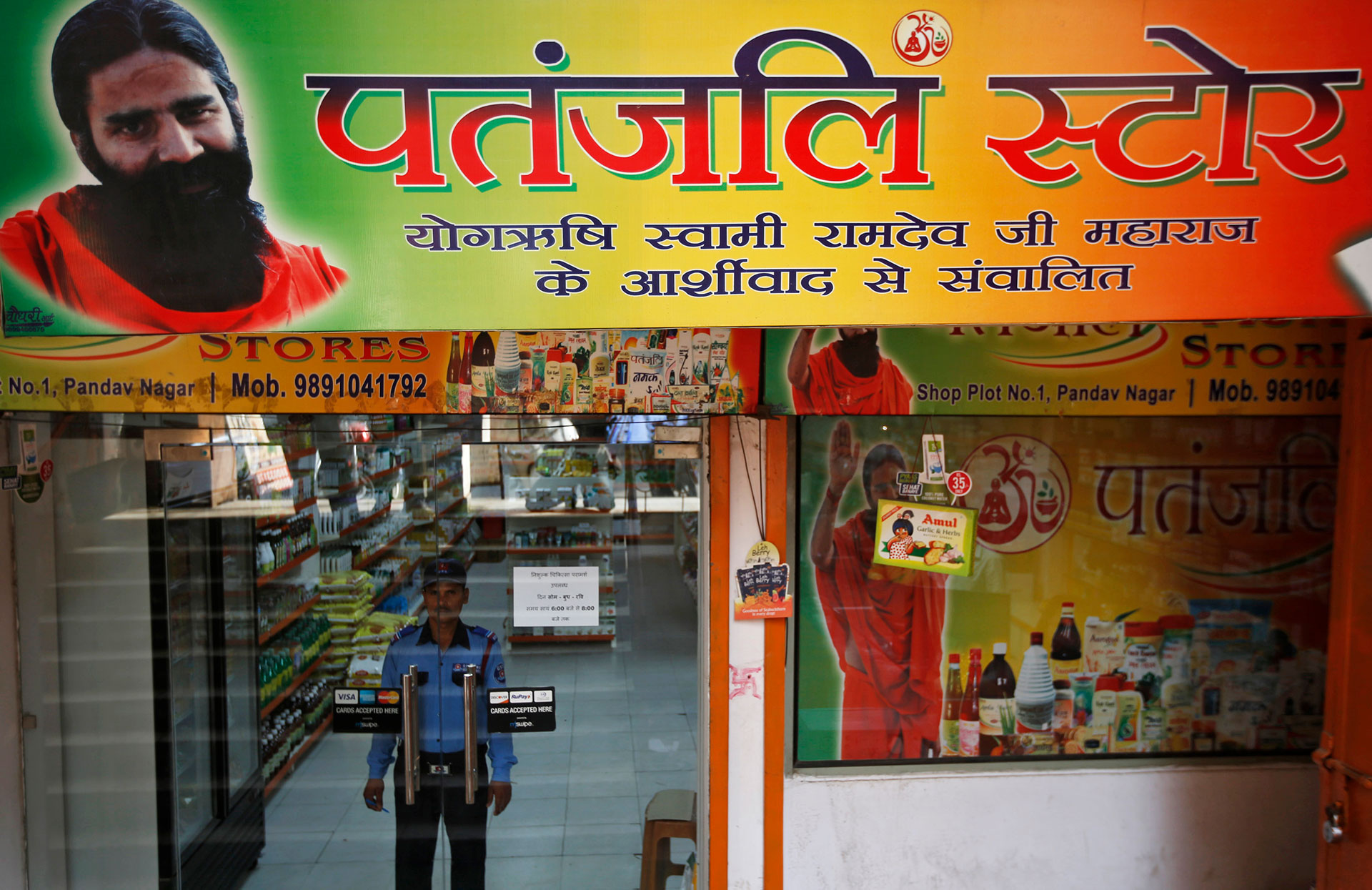 be76df34aa NATIONAL PRESENCE  A security guard watches the entrance to a Patanjali  store in New Delhi earlier this month. REUTERS Adnan Abidi