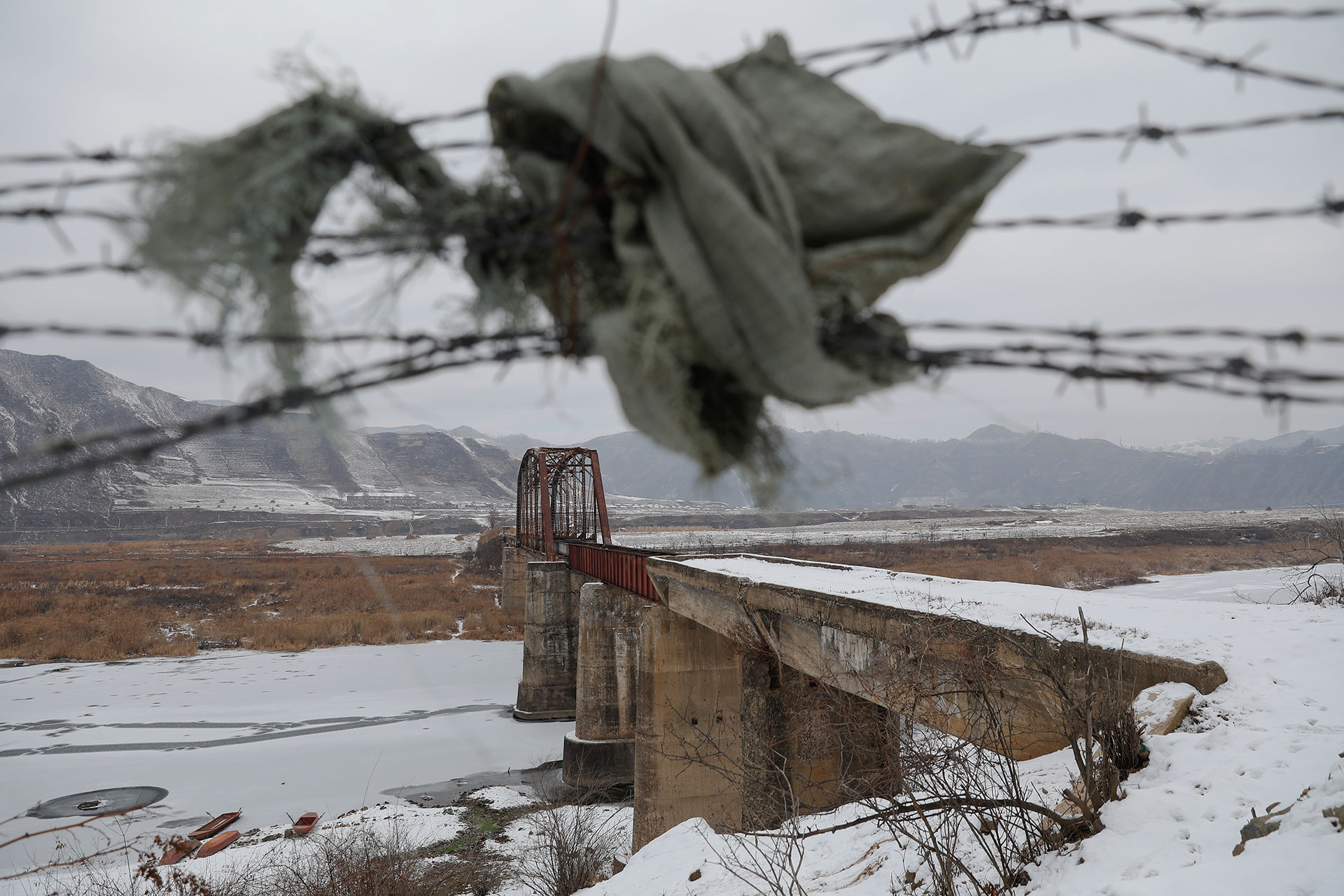 See Ways People Connect Across North Koreas Frontier With China How To Wire A Small Boat Entrance Piece Of Clothing Holds Back Barbed On The Chinese Side Korean Border Below Bridge Boats Wait