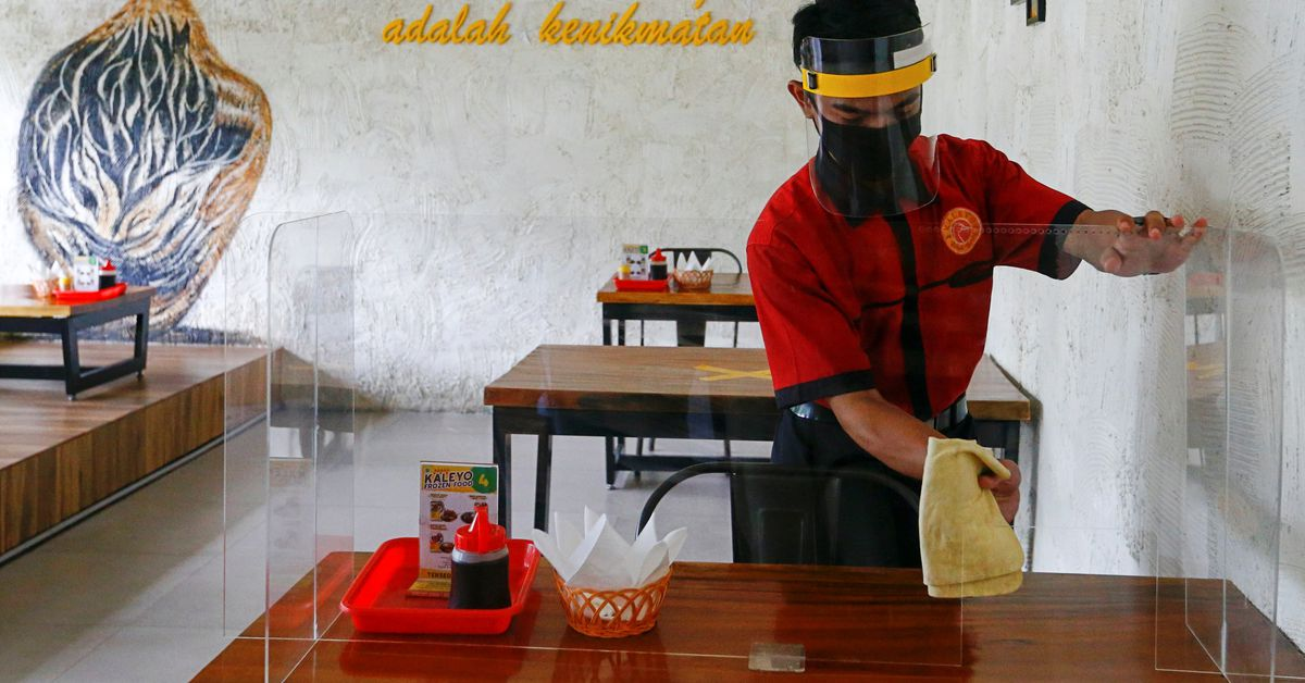 www.reuters.com: Indonesia eases COVID-19 curbs as cases drop from peak