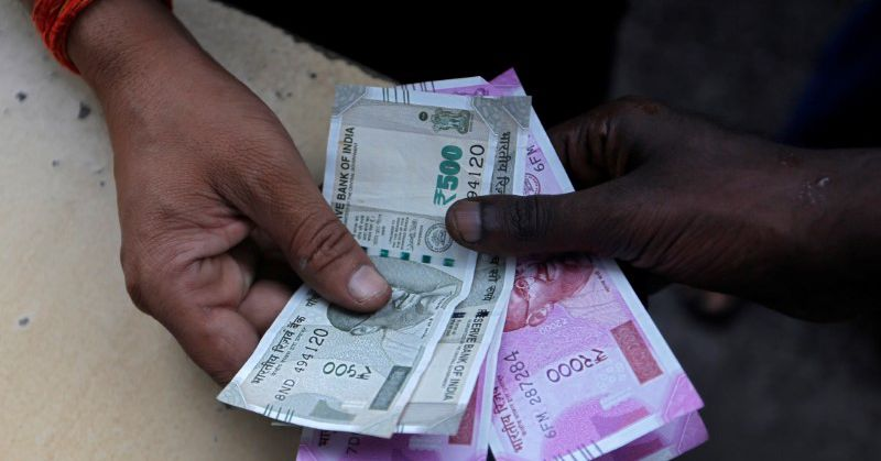 Indian bond yields ease, rupee gains post retail inflation data - Reuters