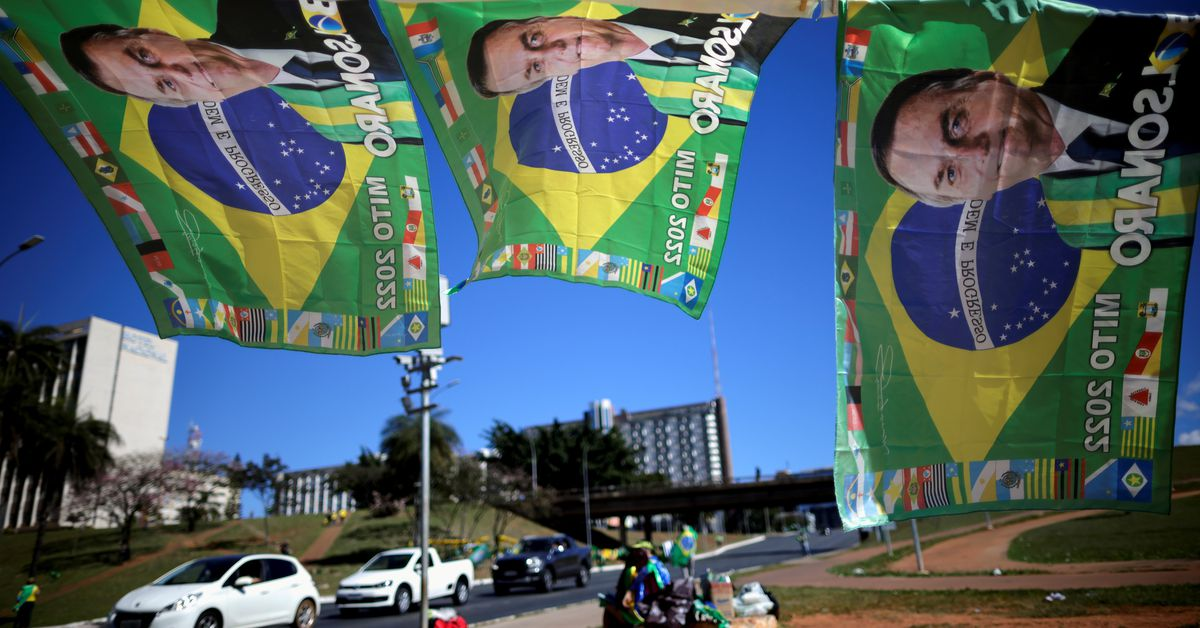 Flags with the image of Brazil's President Jair Bolsonaro are seen displayed for sale during a protest in support of him, amid the coronavirus di