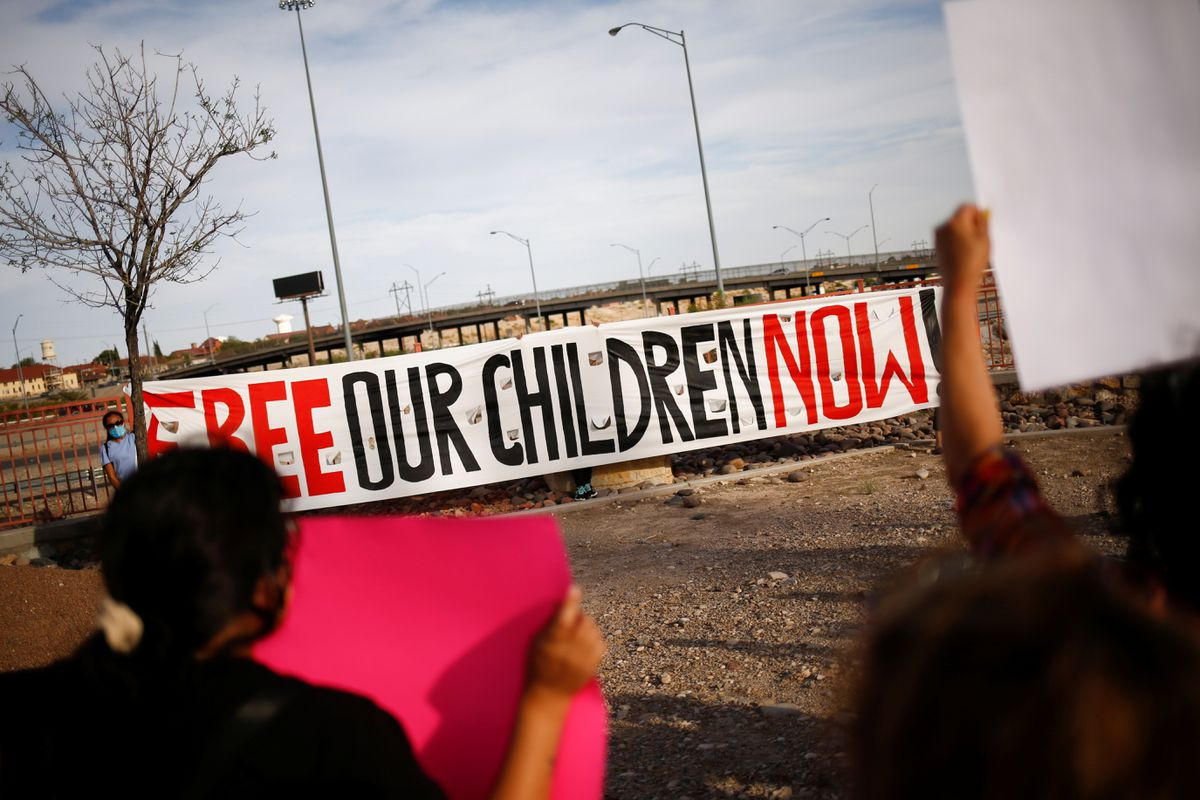 Activists defending the rights of migrants hold a protest near Fort Bliss to call for the end of the detention of unaccompanied minors at the facility in El Paso, Texas, U.S, June 8, 2021. REUTERS/Jose Luis Gonzalez