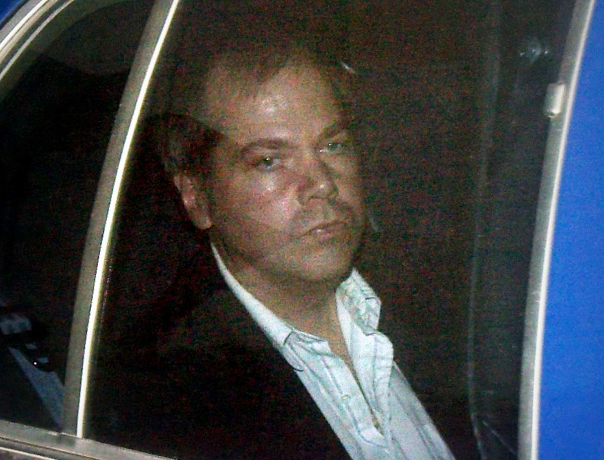 Reagan's shooter out of prison unconditionally