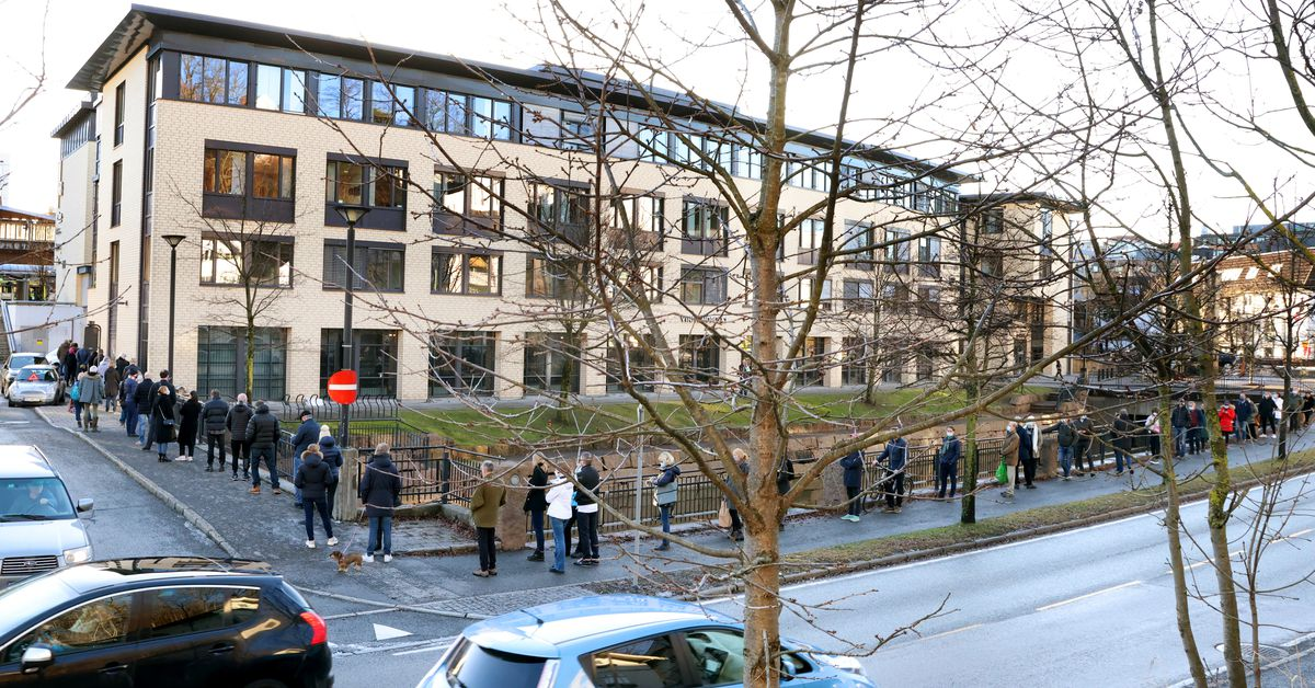 People queue with social distancing outside the liquor store in Sandvika outside Oslo, Norway January 23, 2021 as all liquor store where closed in Osl