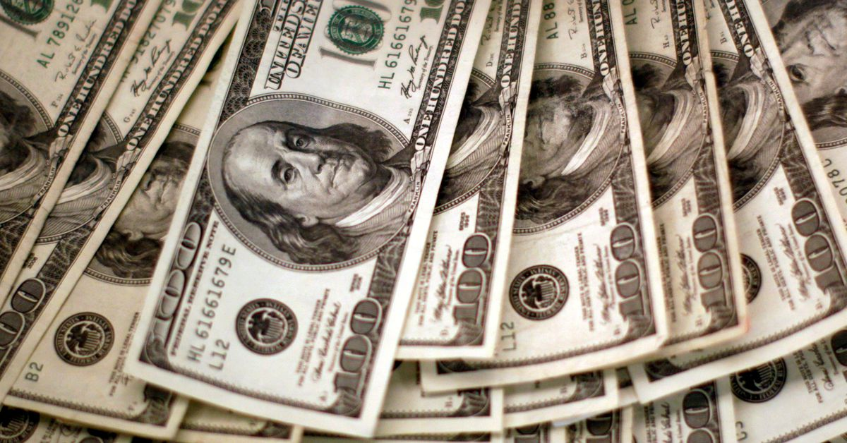 Dollar holds gains after Fed boost; bitcoin tumbles - Reuters