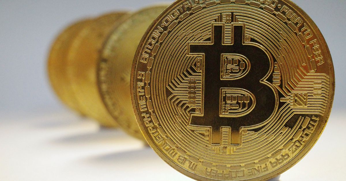 Riding the crypto rollercoaster: Bitcoin nears record high - Reuters