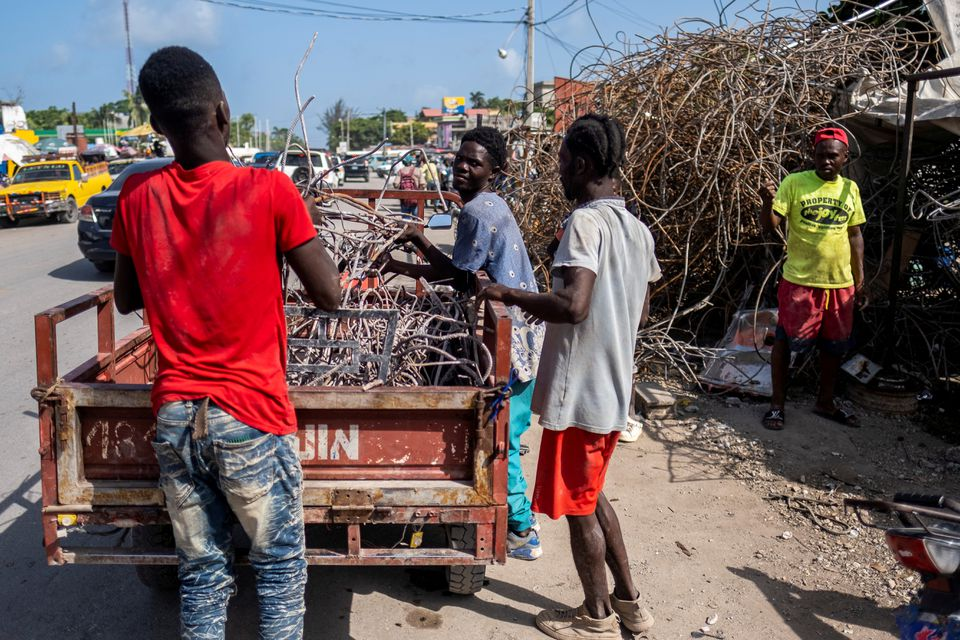 Haitians 'Trying to Survive' by Recycling Scrap Metal Post-earthquake