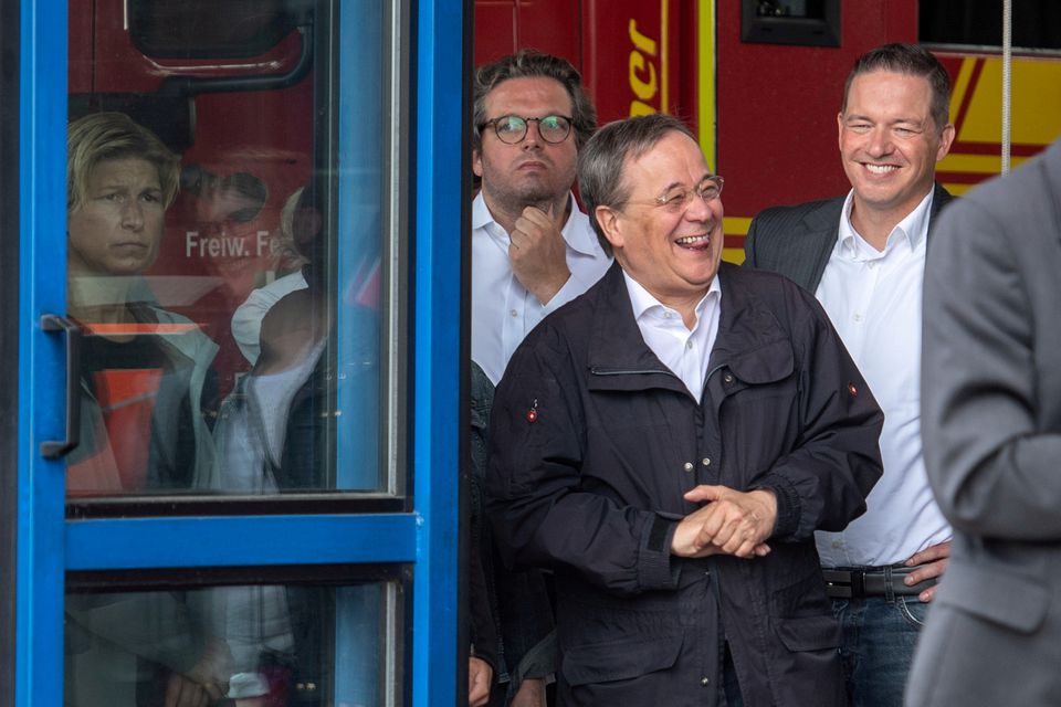 Germany's Laschet who is to Replace Angela Merkel as Chancellor Apologizes for Laughing while Visiting Flood Town
