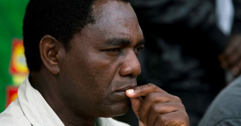 Zambians vote in tight presidential election, web restricted