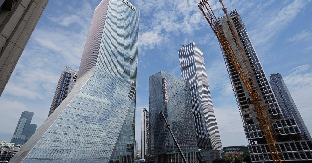 Evergrande's tortuous restructuring, asset sales in focus after default averted